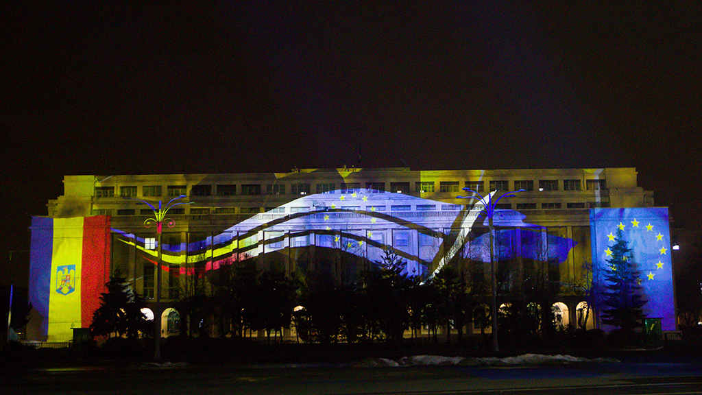 The Victoria Palace, the headquarters of the Romanian Government, illuminated with the logo of the Romanian Presidency of the Council of the European Union